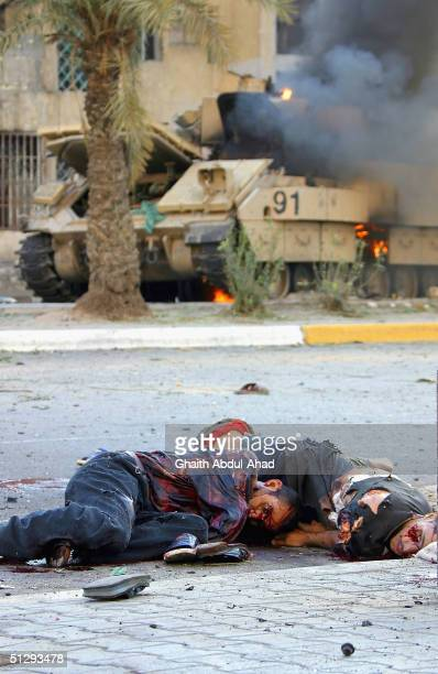 Dead and critically injured Iraqi civilians are seen lying in the street on September 12 2004 in Haifa Street Baghdad Iraq Fighting broke out in the...