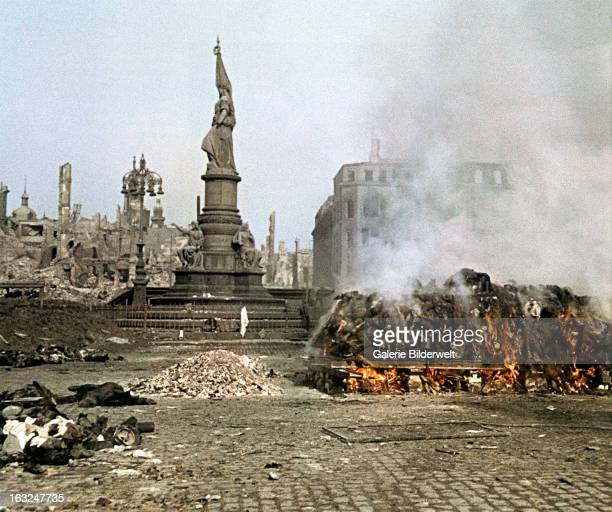 Dead bodies are burned at the Altmarkt near the Victory Monument 25th February 1945In four raids between February 13th and 15th bombers of the...