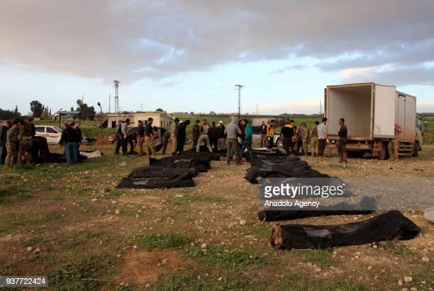 Dead bodies are seen after Free Syrian Army fighters found mass grave in recently liberated Kucuk Meydan village during search efforts after getting...