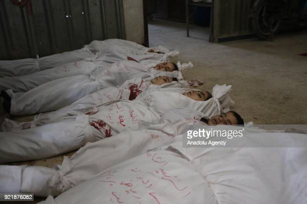 Dead bodies are seen at the morgue of a field hospital after Assad Regime forces carried out airstrikes over Arbin town of the Eastern Ghouta region...