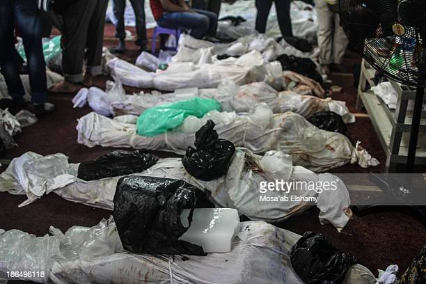 CONTENT] Dead bodies are seen in Iman mosque a day after Rabaa Adaweya clearing which left over 800 killed