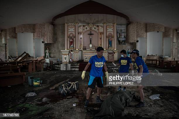 Dead bodies are taken away from a church to a morgue in Tacloban, on the eastern island of Leyte on November 12, 2013 after Super Typhoon Haiyan...