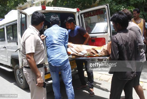 Dead bodies being taken for the post mortem at Sector 49 on July 1 2019 in Gurugram India A PhD scholar Prakash Singh allegedly slit the throat of...
