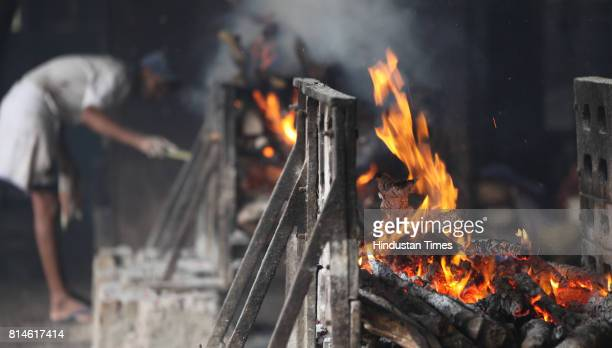 Dead bodies burn at Chandanwadi cemetery on Thursday who died in the Opera House bomb blast in Mumbai