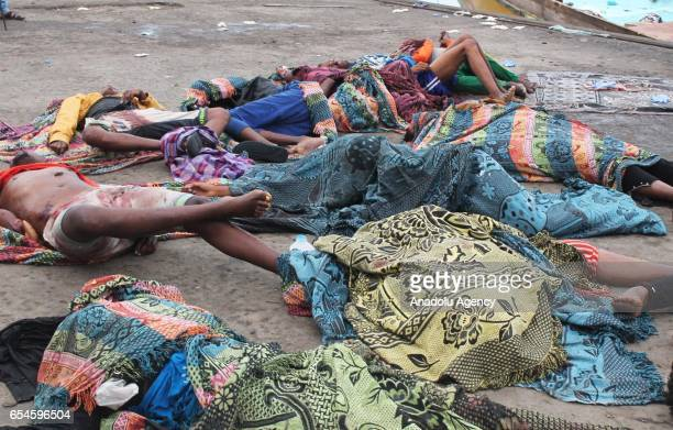 Dead bodies lay on the coast after airstrike hit a boat carrying Somali migrants including women and children who were heading to Sudan in Red Sea on...