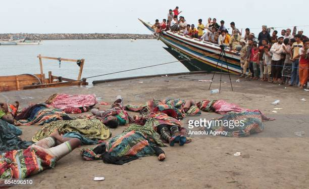 Dead bodies lay on the coast after airstrike hit a boat carrying Somali migrants, including women and children who were heading to Sudan, in Red Sea,...