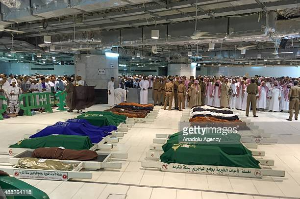 Dead bodies lie at the mosque during the funeral for 29 of 107 the crane collapse victims at Masjid alHaram Mecca Saudi Arabia on September 15 2015...
