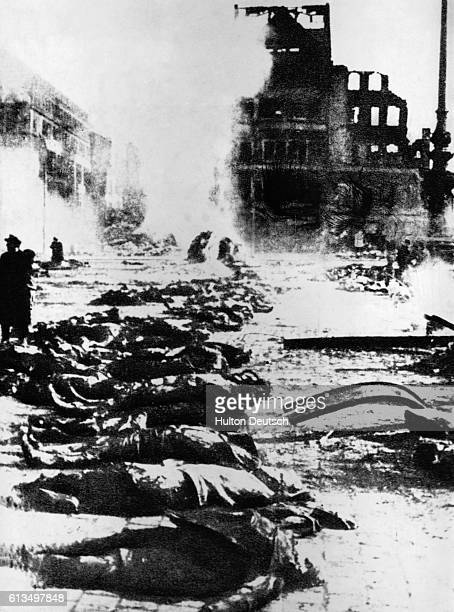 Dead bodies lie in a street in Dresden after a bombing raid on the city