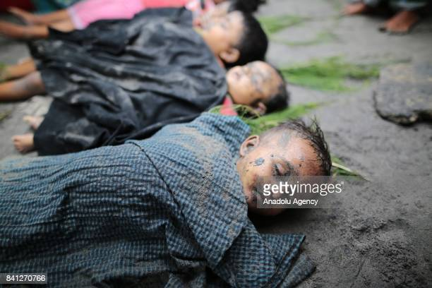 Dead bodies of 10 Rohingya children are seen on the ground who had killed after a boat carrying Rohingya people capsized off Bangladeshs southeastern...