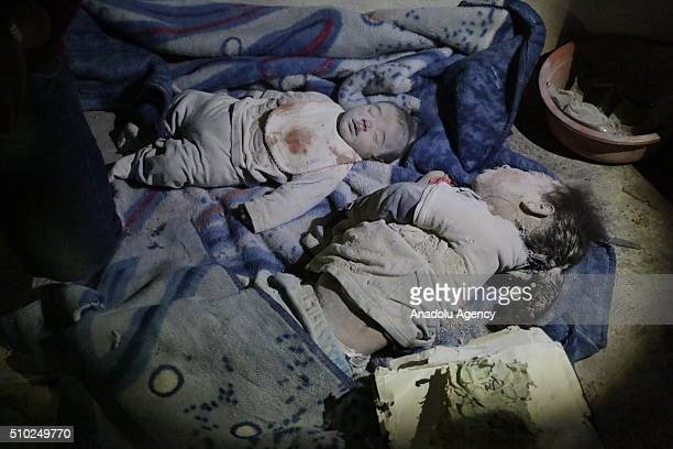 Dead bodies of 3monthold baby Hamza Abdullah and his 6yearold sister Hamsa Abdullah are seen after the Russian airstrikes targeted residential areas...