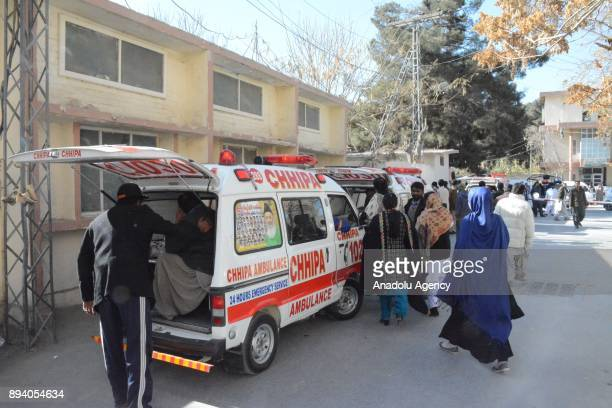 Dead bodies of a bomb attack victims are taken to a hospital with ambulances after a suicide attack at Bethel Memorial Methodist Church in Quetta...