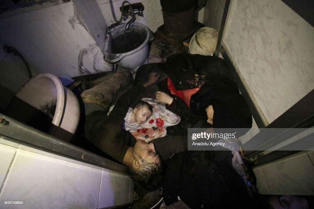 Dead bodies of a Syrian family are seen after Assad regime forces allegedly conducted poisonous gas attack to Duma town of Eastern Ghouta in Damascus, Syria on April 07, 2018.