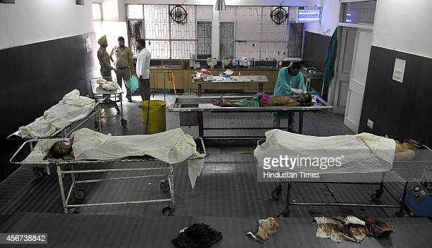 Dead bodies of four villagers killed in firing by the Pakistani forces lie in the morgue after postmortem in Government medical college on October 6...