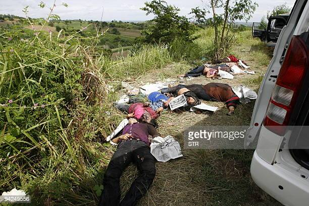Dead bodies of victims of massacre lie next to a vehicle after gunmen shot at least 22 people in Ampatuan town Maguindanao province on November 24...