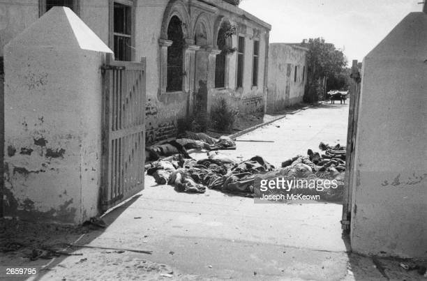 Dead bodies slumped in an Egyptian cemetery after being killed by an English and French bombardment Original Publication Picture Post 8735 Death Wore...