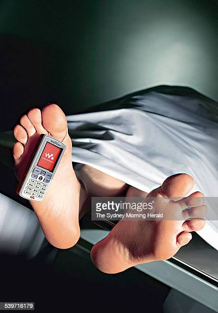 A dead body in the morgue with a mobile phone toe tag 2 September 2004 SMH Picture by QUENTIN JONES
