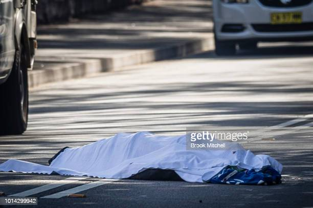 A dead body is pictured on August 10 2018 in Sydney Australia A man was found dead in the street near the intersection of Hereford Street and Minogue...