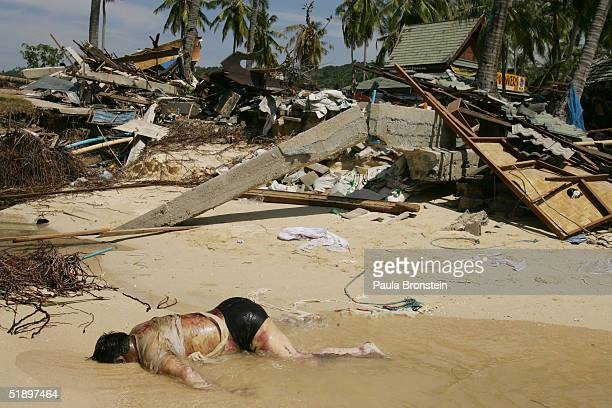 A dead body lies on the beach December 28 2004 on Phi Phi Village on Ton Sai Bay Thailand On Phi Phi Island hundreds were killed when an earthquake...
