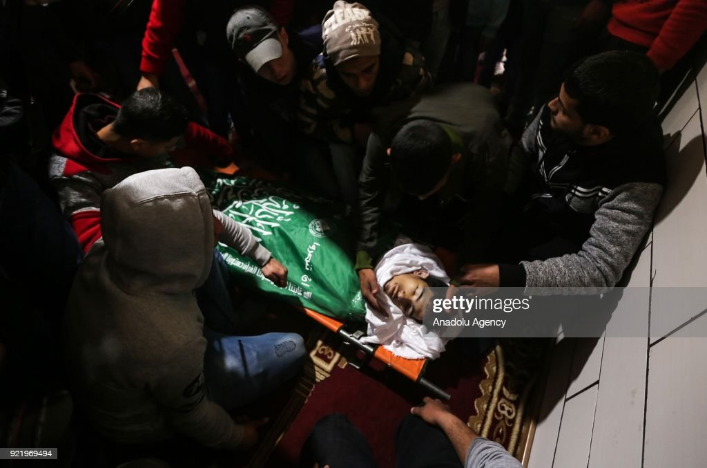 Dead body of 19-years-old Ahmed Ebu Helou, who was killed by Israeli forces on protest against US decision to recognize Jerusalem as Israel's capital, is seen during a funeral ceremony at Al-Beric refugee camp in Gaza City, Gaza on February 21, 2018.