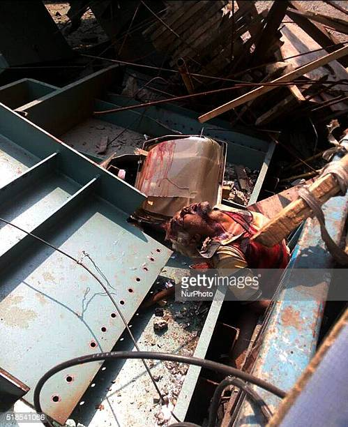 Dead body of a Man in the debris of partially collapsed overpass in Kolkata on April 12016At least 22 people have been killed and several injured...