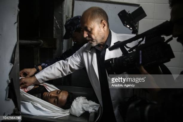 Dead body of a Palestinian kid Mohamed Nayef alHoum who was shot dead by the Israeli forces near the Gaza Strips border with Israel is seen in the...