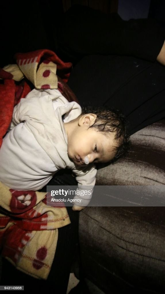 Dead body of a Syrian kid is seen after Assad regime forces allegedly conducted poisonous gas attack to Duma town of Eastern Ghouta in Damascus, Syria on April 07, 2018.