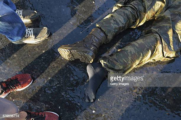 Image contains graphic content A dead body of a Turkish soldier lies on the ground after soldiers involved in the coup attempt surrendered on...