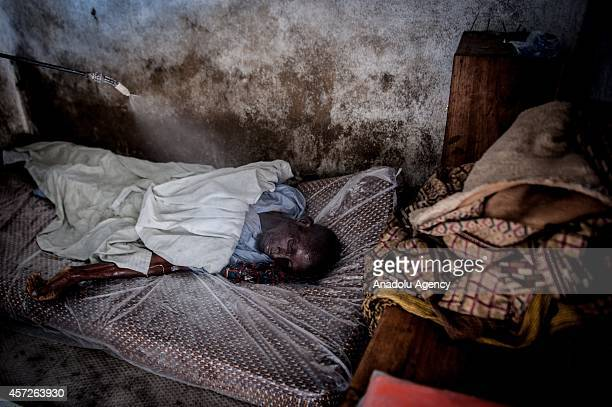 Dead body of Mambodou Aliyu died due to the Ebola virus is seen on his bed in a house in Monrovia Liberia on October 15 2014