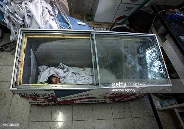 Dead body of Raghad Masoud is stored in a freezer previously used to store icecream because the Kuwaiti hospital morgue is full at the Rafah refugee...