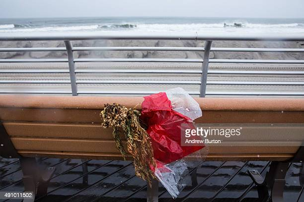 A dead bouqet of flowers sits on a bench along the boardwalk during the potential build up to Hurricane Joaquin on October 2 2015 in Long Beach New...