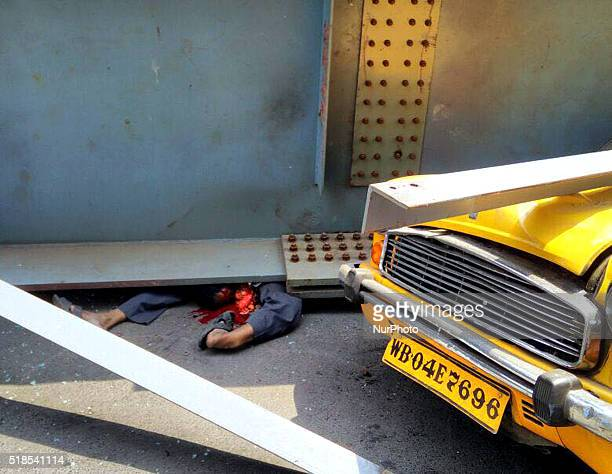 Dead boy of a man in the debris of partially collapsed overpass in Kolkata on April 12016At least 22 people have been killed and several injured...