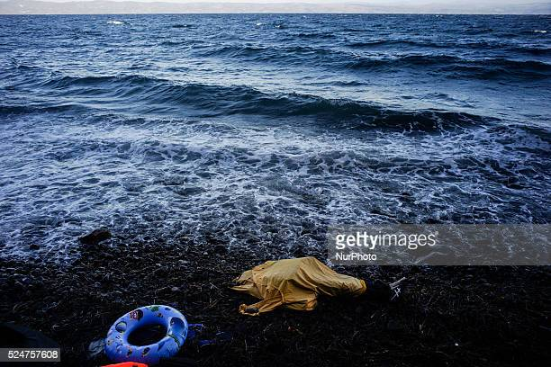 A dead boy's body covered on the shore of Skala Sikamineas after the sea washed him out Lesbos November 1 2015