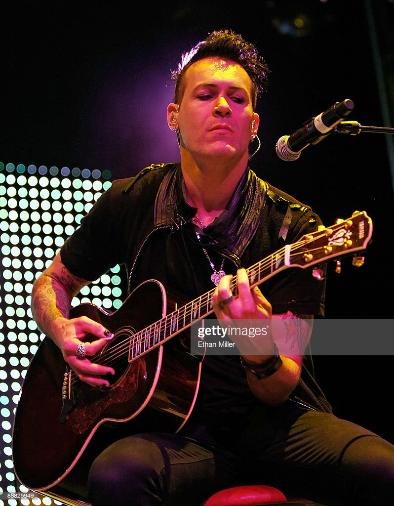 Dead By Sunrise guitarist Ryan Shuck performs during an acoustic concert at the Steve Wyrick Theatre as part of the grand opening celebration of Linkin Park singer Chester Bennington's Club Tattoo inside the Miracle Mile Shops at the Planet Hollywood Resort & Casino July 4, 2009 in Las Vegas, Nevada. Dead By Sunrise, a side project band by Bennington and members of the rock group Julien-K, will release the album, 'Out of Ashes' this September.