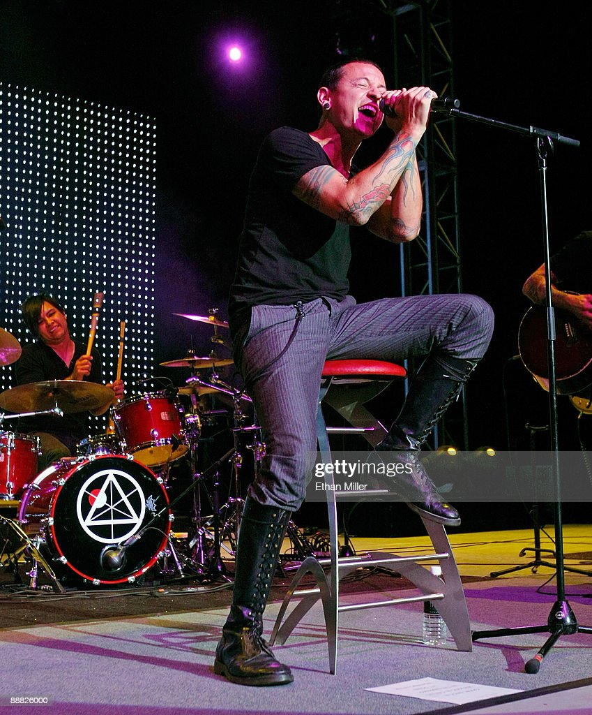 Dead By Sunrise singer Chester Bennington (R) and drummer Elias Andra perform during an acoustic concert at the Steve Wyrick Theatre as part of the grand opening celebration of Bennington's Club Tattoo inside the Miracle Mile Shops at the Planet Hollywood Resort & Casino July 4, 2009 in Las Vegas, Nevada. Dead By Sunrise, a side project band by Linkin Park singer Bennington and members of rock group Julien-K, will release the album, 'Out of Ashes' this September.