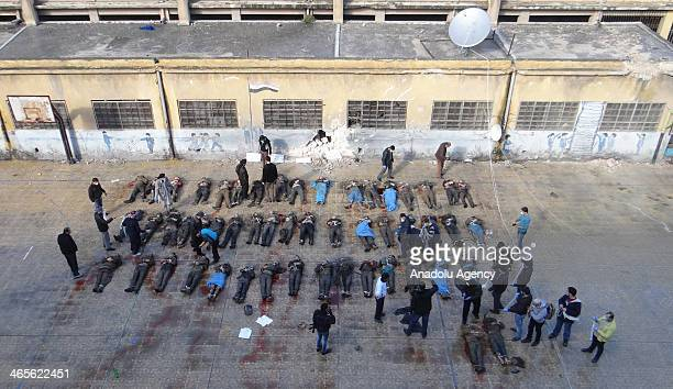 220 dead civilians thrown into the Syrian Queiq river are seen on January 29 2013 in Aleppo Syria New photographs and videos of 220 dead civilians...