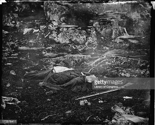 Dead Confederate sharpshooter in Devil's Den during the Battle of Gettysburg, Pennsylvania, July 1863. Photograph by Alexander Gardner.