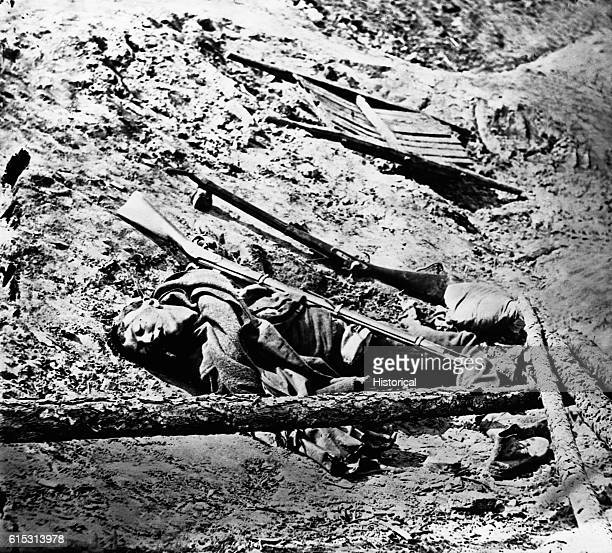 Dead Confederate soldier in the trenches at Petersburg, Virginia, April 3, 1865. Photo attributed to Thomas C. Roche. | Location: near Petersburg,...