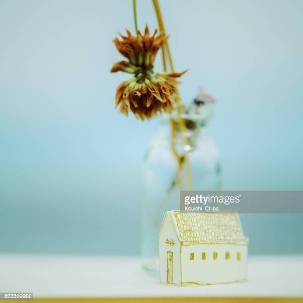 dead flowers and home - kouichi chiba stock photos and pictures