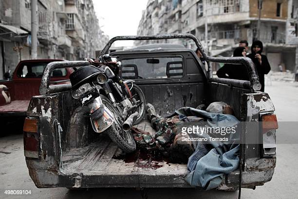 A dead Free Syrian Army soldier lays in the back of a car in Aleppo Syria October 3 2012