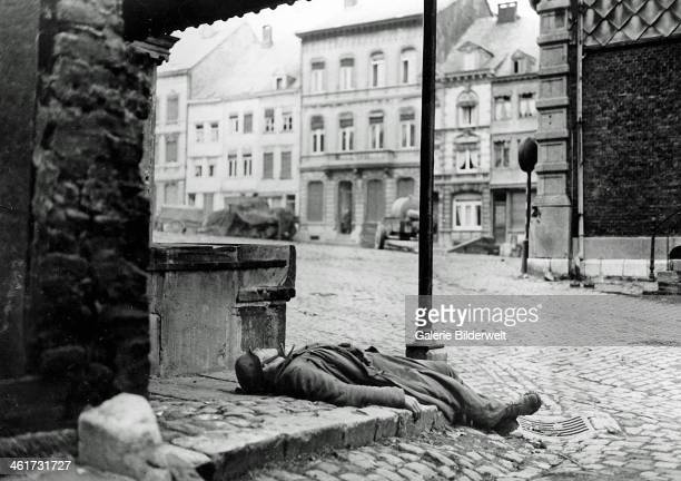 A dead German soldier killed during the German counter offensive in the BelgiumLuxembourg area is left behind on a street corner in Stavelot 2nd...