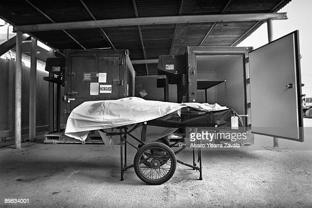 A dead Iraqi Army solder in the morgue at the 28th CSH known as 'China Dragon' at Baghdad hospital