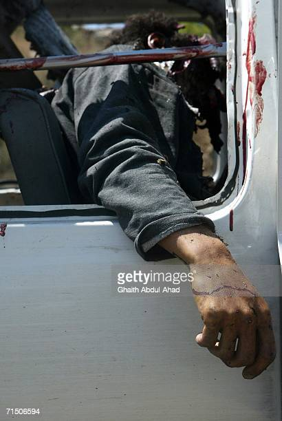 Dead Lebanese civilian is seen inside a van after a rocket from an Israeli aircraft hit their van as they fled their village July 23, 2006 in Tyre,...