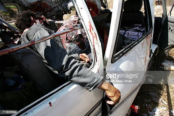 Dead Lebanese civilians are seen inside their van after a rocket from an Israeli aircraft hit their van as they fled their village July 23, 2006 in...