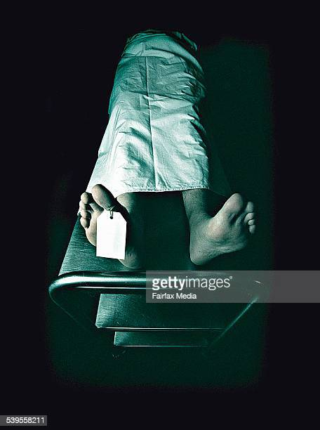 Dead man lying on a trolley in the morgue with toe tag on 28 February 2002 AFR NEWS Picture by LOUIE DOUVIS