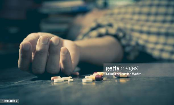 dead man with medicines lying on floor at home - drug overdose stock photos and pictures
