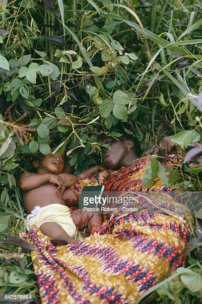 A dead Mandingo mother and child lie in the brush victims of the National Patriotic Front of Liberia who often execute people based on ethnicity...