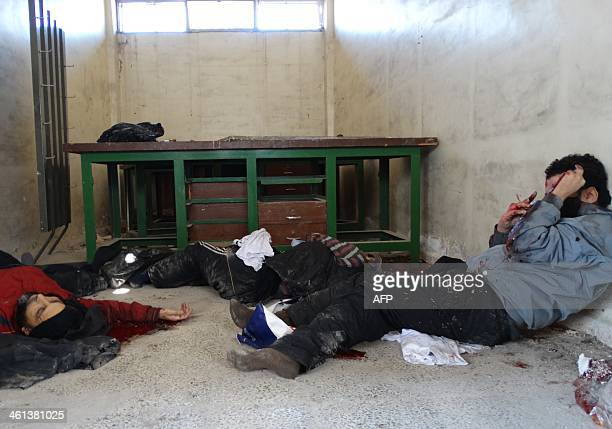 Dead men lie on the ground of the Aleppo headquarters of the Islamic State of Iraq and the Levant after they were allegedly executed by the...