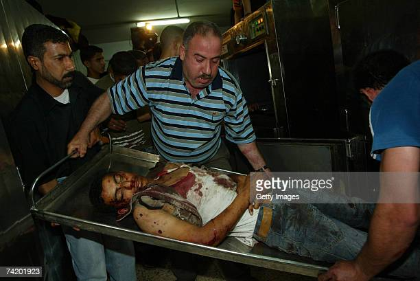 A dead Palestinian is shown at AlShifa hospital following an Israeli strike against the home of a Hamas leader May 20 2007 in Gaza city Gaza Eight...