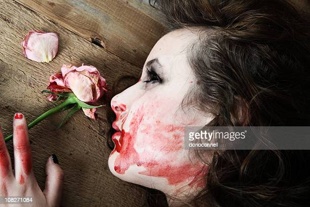 dead rose - female corpse stock photos and pictures