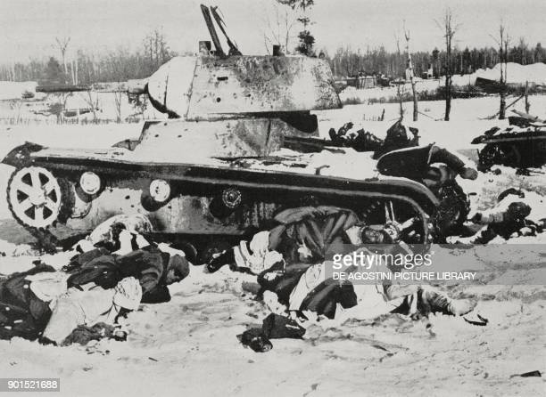 Dead Russian soldiers in front of a tank after a clash with German forces World War II from L'Illustrazione Italiana Year LXIX No 17 April 26 1942